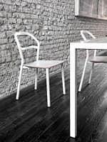 Modern chair with tubular painted steel frame idfdesign for Terrace tubular design