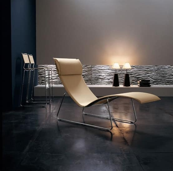Lounge chair in chrome metal leather covering idfdesign for Relax chaise longue