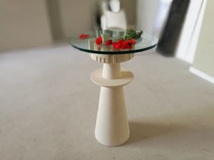 Agor�, Table with glass top, carved stone base