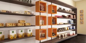 Revolution - shelves for bakeries and cafes, Exhibition wall with rotating cubes
