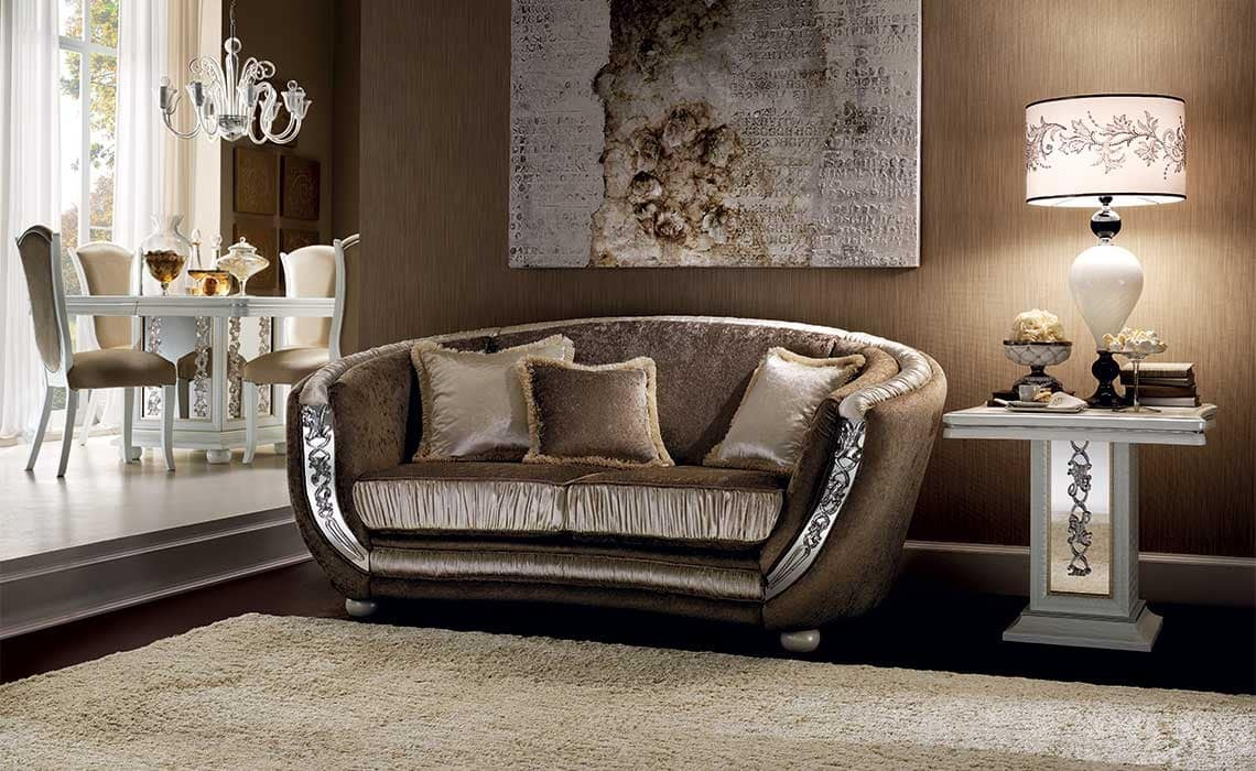 Semi elliptical sofa enriched by precious fabrics idfdesign for Semi classic sofa