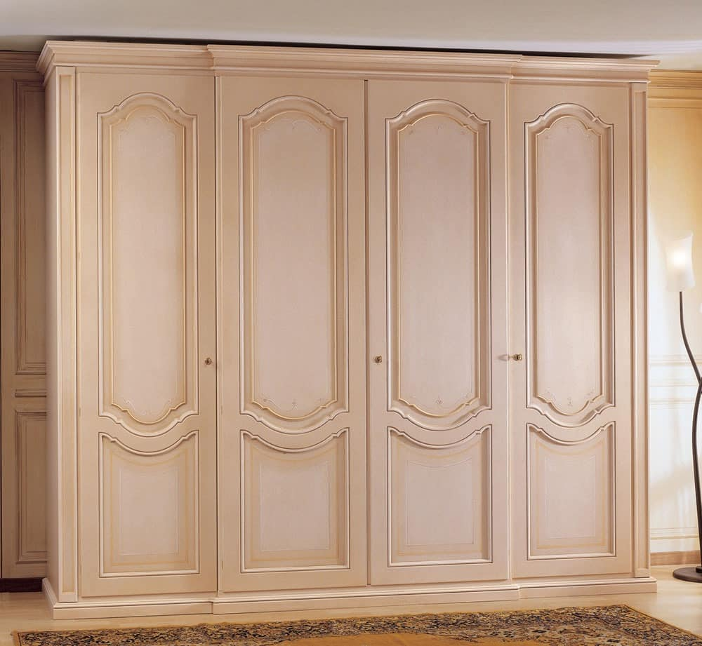 Wooden wardrobe decorated with doors for bedroom