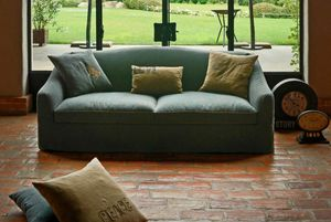 Carolina, Sofa covered in fabric, with rounded armrest
