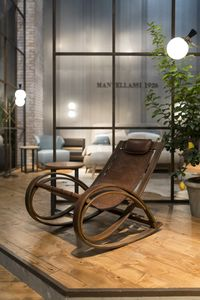 Otto rocking chair, Wooden rocking chair with corten finish, leather seat