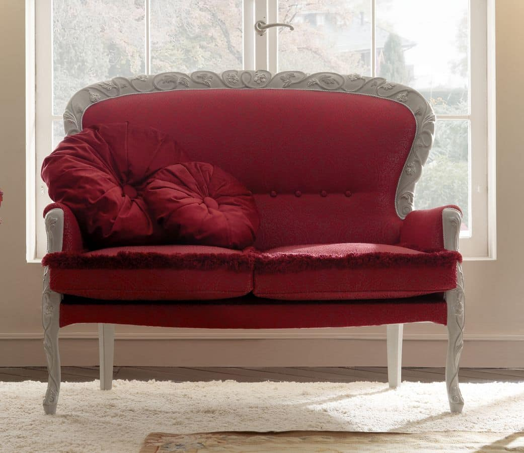Elegant sofa in hand carved wood covered with precious