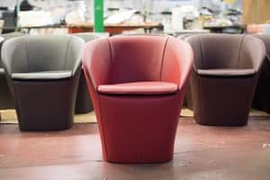 Farra, Modern tub armchair, in leather covered