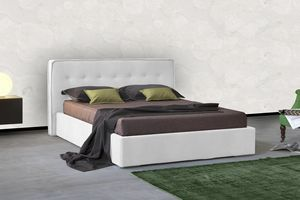 Snap, Bed with decorated upholstered headboard