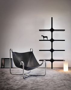 Baffo, Design armchair in leather and metal