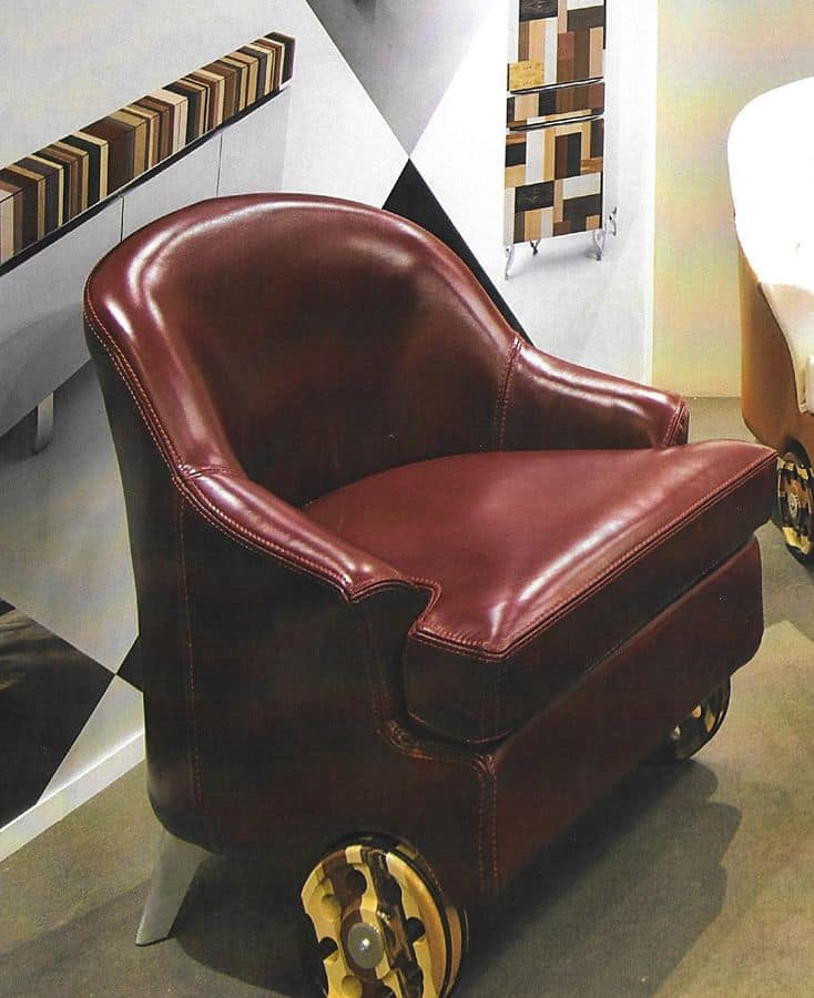 ECLITTICA, Upholstered armchair, covered in leather, with wheels