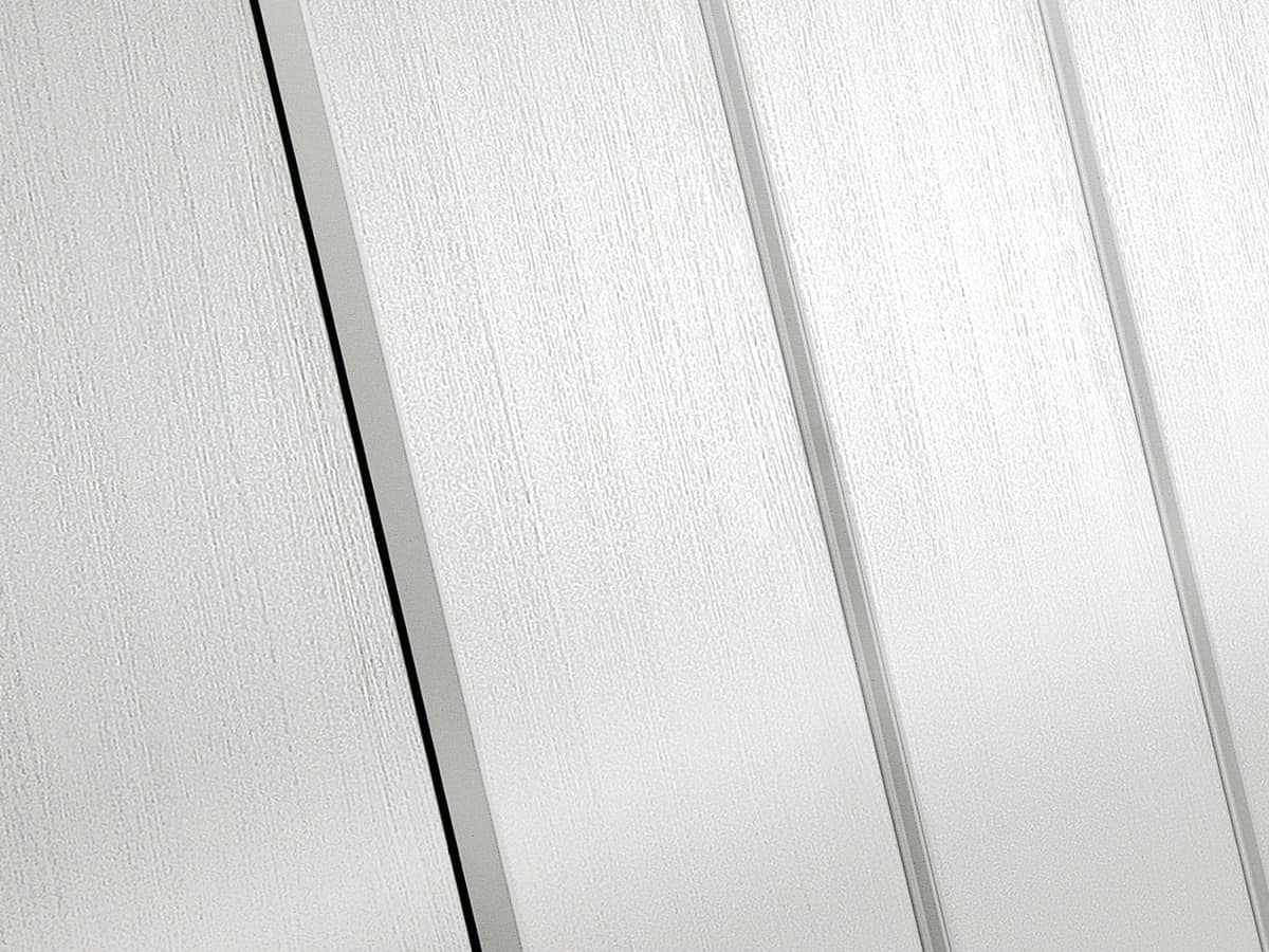 Wardrobe Coo 03, Linear wardrobe with vertical handles on the door edges