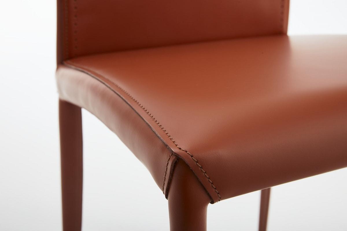 Aisha, Leather chair with ornamental holes