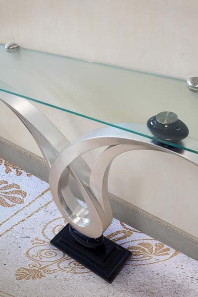 Zodiaco, Console with glass top, structure with silver leaf finish , for hall entrance furnishing
