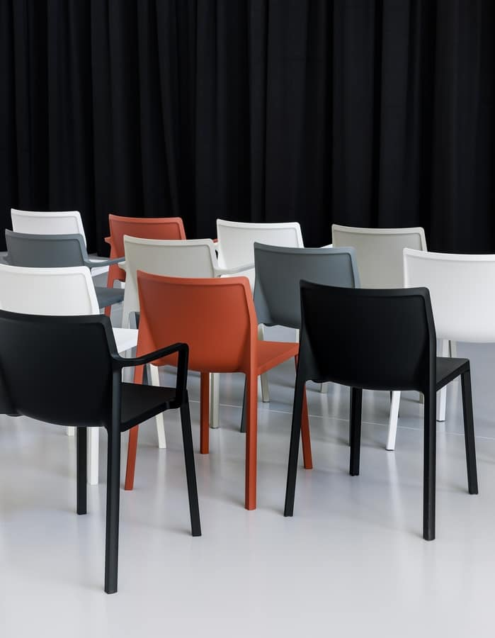 LP stackable with arms, Chair design in glass fiber and polypropylene, with armrests