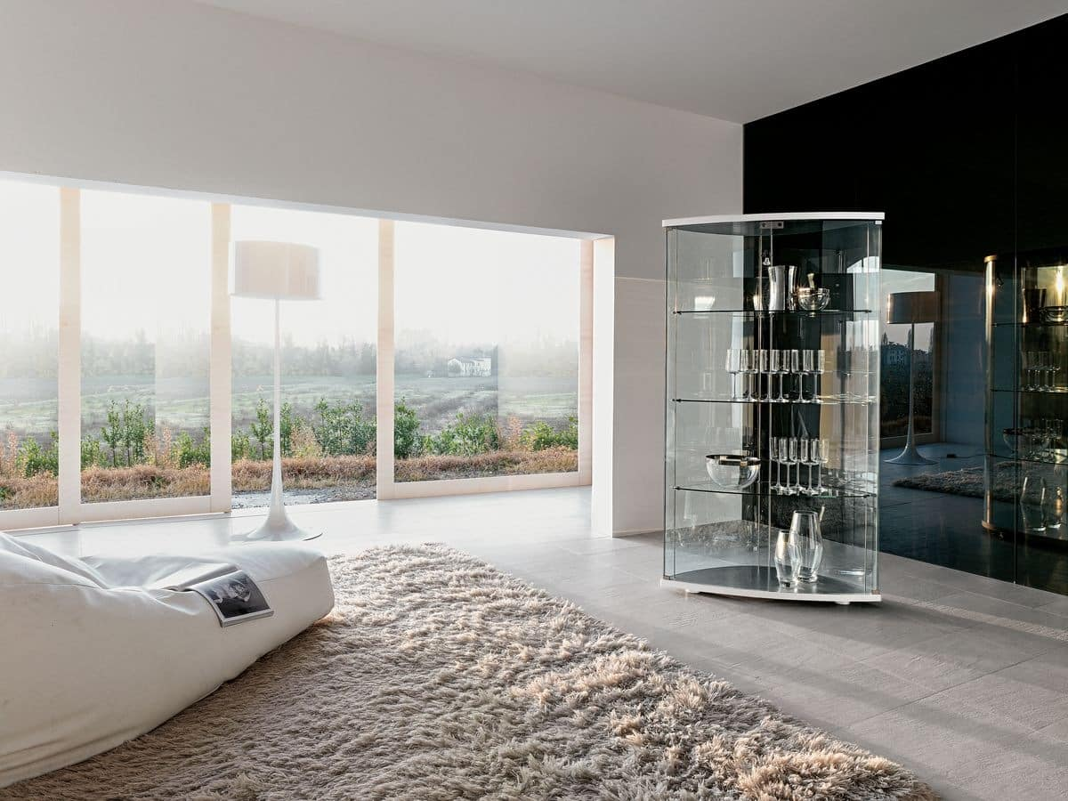 GRACÌA, Exhibiting furniture in curved glass, for modern living room