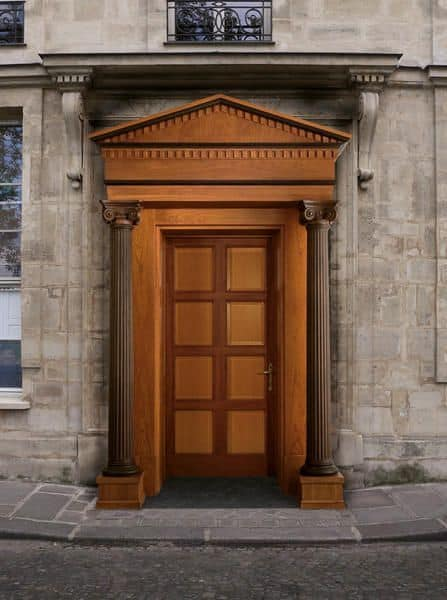 Giove, Wooden front door with columns and capitals, carved by master craftsmen