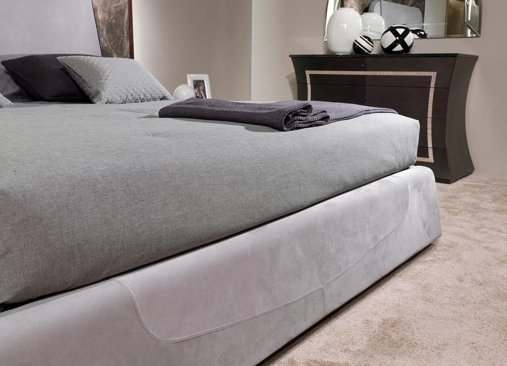LE27 Madison bed, Upholstered bed with visible stitching