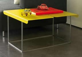 Flap, Magazine-rack made of stainless steel, transformable into coffee table