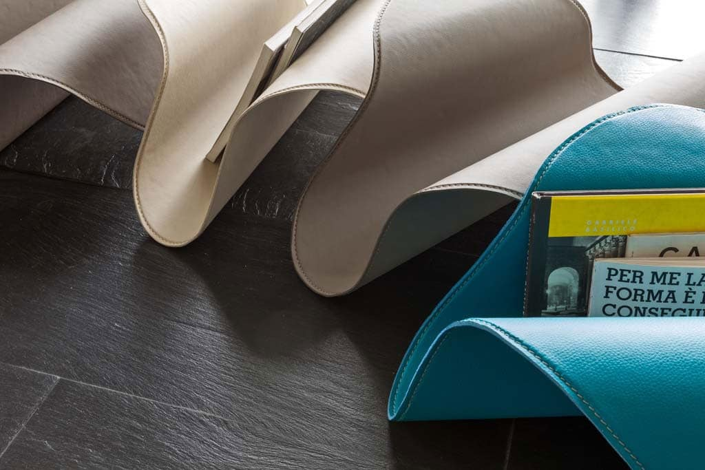 FLY, Magazine holder in curved metal and leather, for home and office