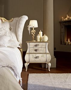 Matilde nightstand, Bedside table with a flattened design, decorated by hand