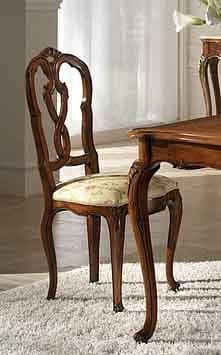 P 601, Walnut chair with upholstered seat and backrest carved
