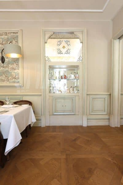 White wooden panelling, White lacquered wood paneling, precious carvings handcrafted, for prestigious  hotels and villas