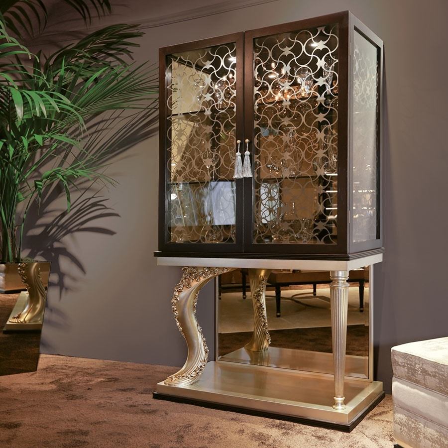 FLORA / display cabinet, Display cabinet with carved base