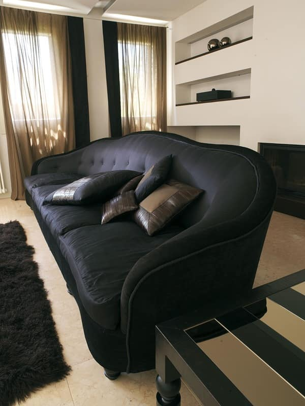 Trivano, Upholstered quilted sofa, turned wooden legs