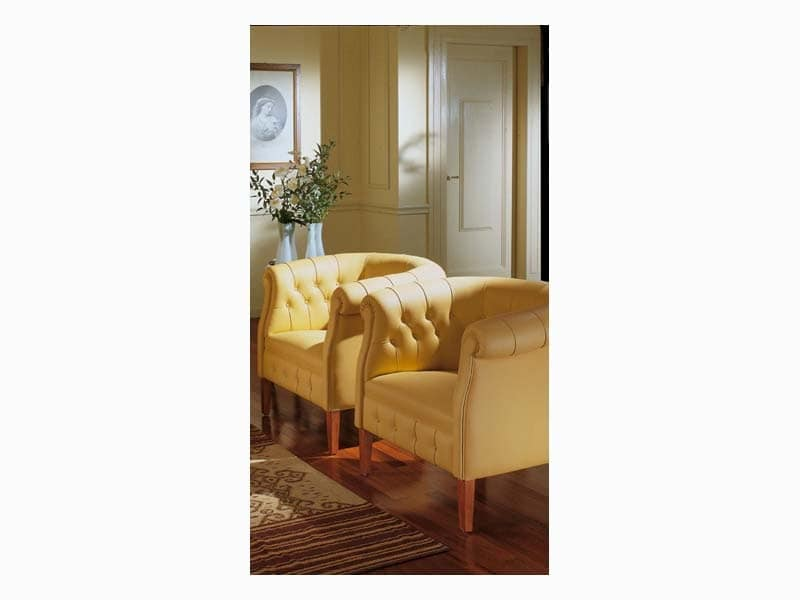 Carol, Decorated armchair in leather, for luxury hotels
