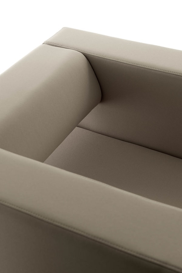 UF 148, Armchair with chromed metal legs, perforated back