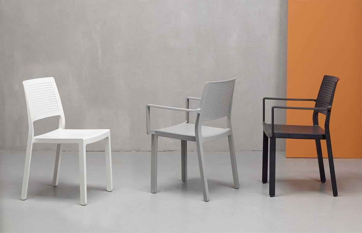NINA P, Stackable armchair with perforated backrest