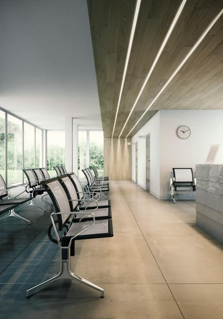 Korner, Bench on beam, sitting on perforated plate, for waiting areas