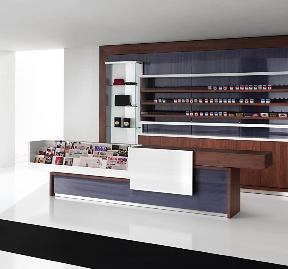 Cash register counter with magazine holder module idfdesign for Riviste interior design