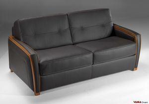 Lido C, Sofa bed with wooden structural elements clearly visible on the armrests