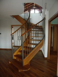 Art. E02, Curved staircase in wood and iron