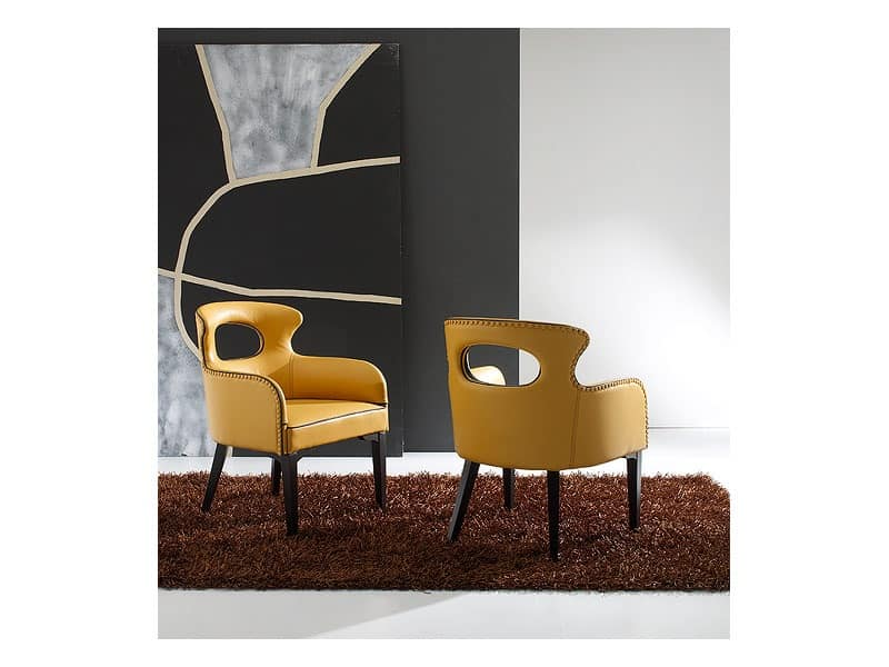 ENNEA, Tub chair covered with mustard colored leather