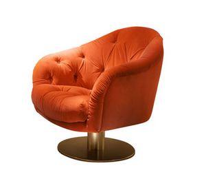 Garbo swivel, Swivel armchair with capitonn� padding