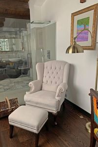 London, Classic berg�re armchair in leather
