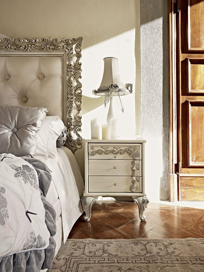 Angelica bed, Bed with tufted headboard and a precious carved frame